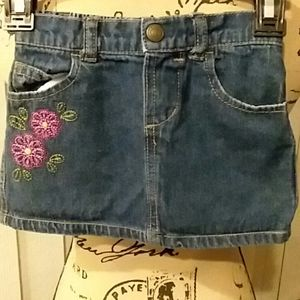 BABY jean skirt. Embroidery on the front. Like new